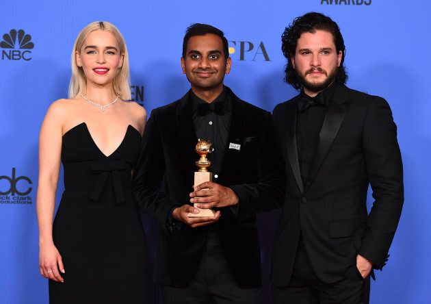 """Aziz Ansari poses with his Golden Globe for Best Performance by an Actor in a Television Series (Musical or Comedy) for """"Master of None"""" at the 75th annual Golden Globe Awards at the Beverly Hilton Hotel on Jan. 7, 2018, along with """"Game of Thrones"""" stars Emilia Clarke and Kit Harington."""