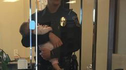 'Hero' Cop Holds Baby For Hours While Mom Files Domestic Violence
