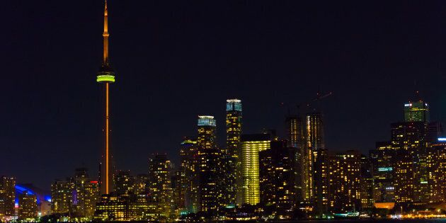 Night view of the Toronto skyline from inside the waters of Lake Ontario. After a violent year, Toronto...