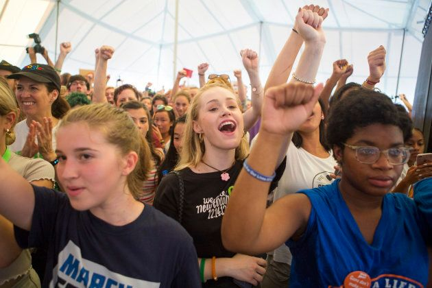 Young audience members react to speakers at a March for Our Lives rally, on Aug. 12, 2018 in Newtown,