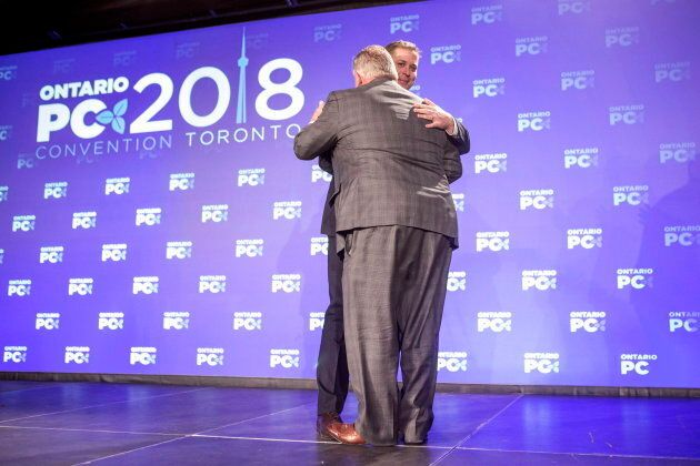 Federal Conservative Leader Andrew Scheer, right, is embraced by Ontario Premier Doug Ford after addressing...