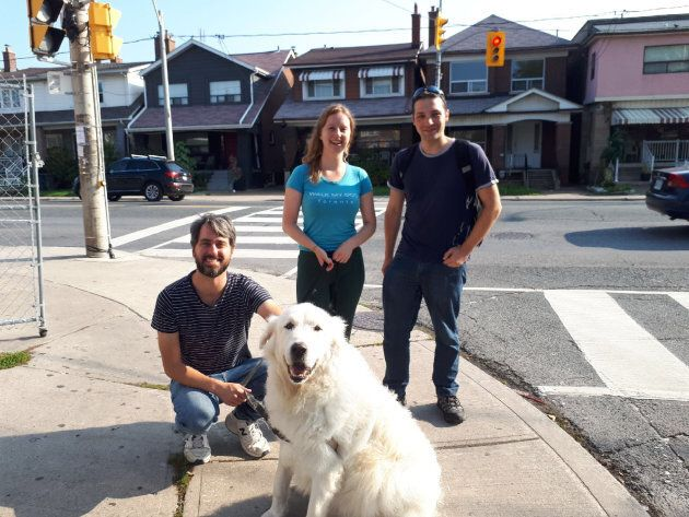 Gilleen Pearce poses with her husband and Walk My Dog Toronto co-founder Colin and Eric, a staff
