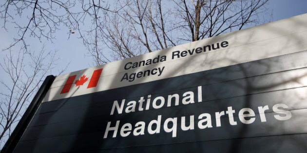 A sign is pictured in front of the Canada Revenue Agency (CRA) national headquarters in Ottawa, March...