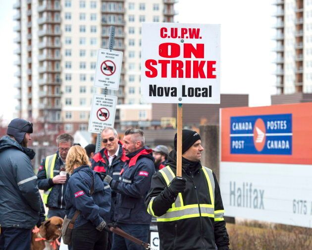 Canada Post workers walk the picket line as a rotating strike continues in Halifax on Nov. 13,