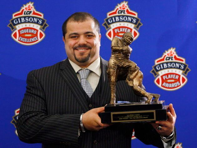 Marwan Hage holds the Tom Pate Memorial Award, recognizing a CFL player with outstanding sportsmanship,...