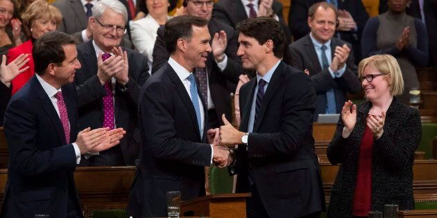 Prime Minister Justin Trudeau shakes hands with the Finance Minister Bill Morneau following the fiscal...
