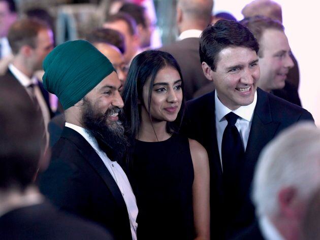 Prime Minister Justin Trudeau poses for a photo with NDP Leader Jagmeet Singh and his wife Gurkiran Singh at the Parliamentary Press Gallery Dinner in Gatineau, Que., on May 26, 2018.