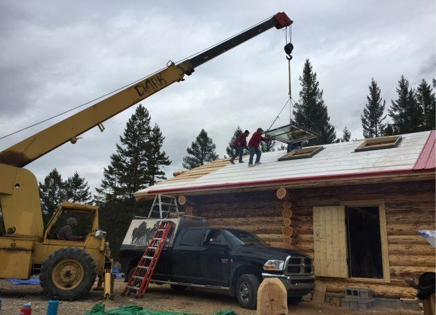 The 50-year-old Clark crane, a beast of a machine that Grandpa Tony kinda sorta accidentally bought, works to lift up the cabin's skylights.