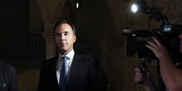 Finance Minister Bill Morneau arrives in the foyer after tabling the Fall Economic Statement at the House of Commons  on Nov. 21, 2018.