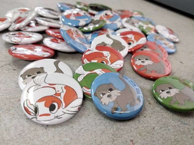 Non-profit group Chinatown Today is selling buttons featuring cartoon koi and otter drawn by artist Pearl...