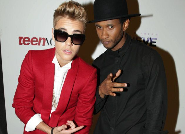 """Justin Bieber poses with Usher Raymond at the premiere of Open Road's """"Justin Bieber's Believe"""" on Wednesday, Dec. 18, 2013 in Los Angeles."""