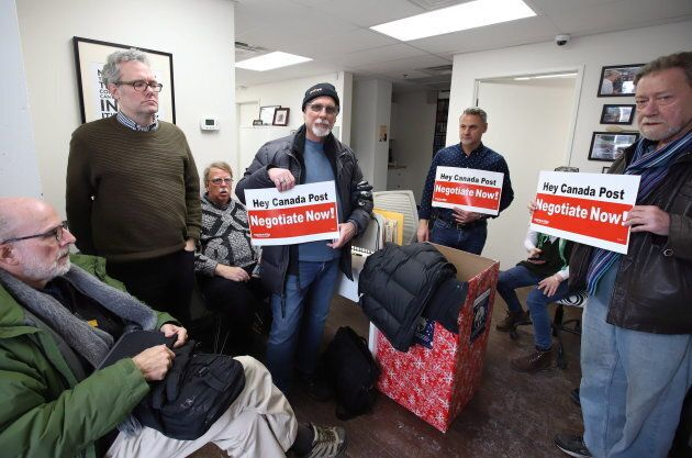 Members of the Canadian Union of Postal Workers occupy Minister of Environment Catherine McKenna's community office in Ottawa on Nov.  23, 2018.