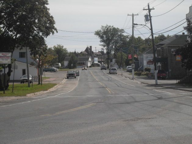 Saunders Road in McAdam, N.B. is shown, with the McAdam railway station in the background.