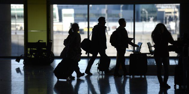 Passengers arriving at Terminal 1 of Lester B. Pearson International Airport, Toronto, Dec. 30, 2013....
