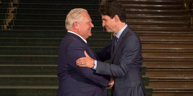 Ontario Premier Doug Ford greets Prime Minister Justin Trudeau at the Ontario Legislature in Toronto...