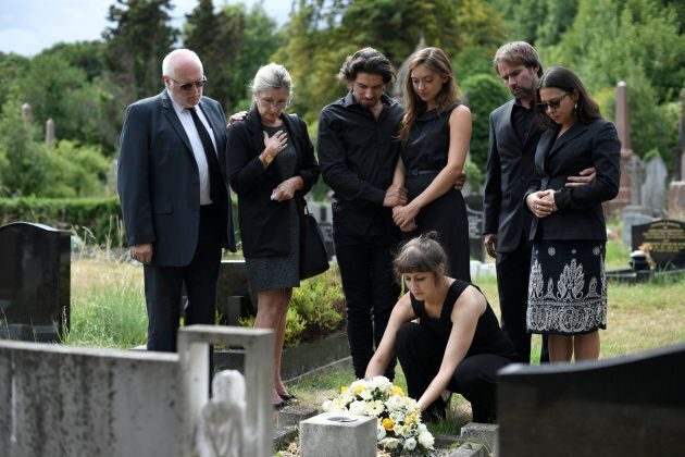 Family laying flowers on the
