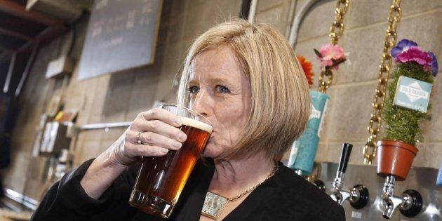 Alberta Premier Rachel Notley drinks a beer while touring the Cold Garden Beverage Company in Calgary...