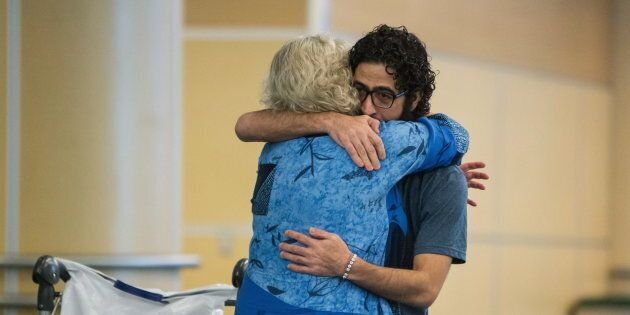 Hassan Al Kontar hugs Laurie Cooper after arriving in Vancouver after flying from Kuala Lumpur in Vancouver...