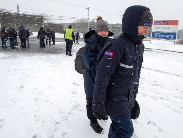 Canada Post workers return to work after the government ordered them to end their rotating strike on...