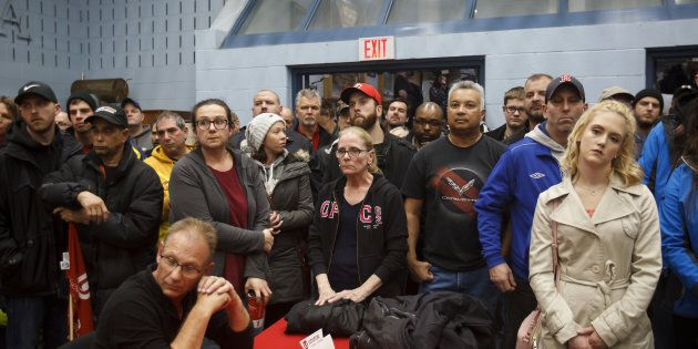 General Motors Co. workers gather for an information meeting at Unifor Union Hall in Oshawa, Ont., Mon. Nov. 26. GM announced on Monday that the Oshawa plant will be