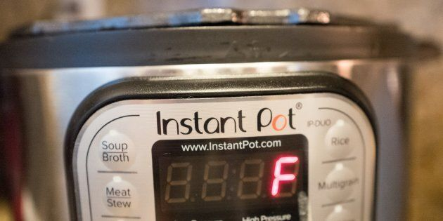 F is right. Close-up of an Instant Pot, a popular automatic pressure cooker that's attracted a cult following...