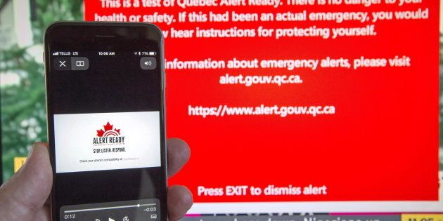 A smartphone receives visual and audio alerts to test Alert Ready, a national public alert system, in...