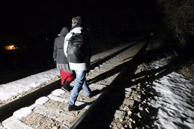 Migrants from Somalia cross into Canada illegally from the United States by walking down this train track...