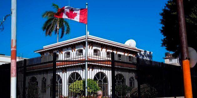 A man walks beside Canada's embassy in Havana, Cuba on April 17,
