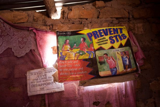 An educational poster advocating safe sex practices (such as sticking to one partner and using condoms) in a town on the border of Zambia and Zimbabwe,
