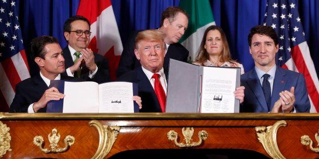 President Donald Trump (C) Prime Minister Justin Trudeau, and Mexico's President Enrique Pena Neto, left,...