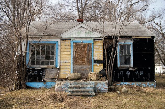 An abandoned house sits in a neighbourhood north of downtown Flint, Mich.