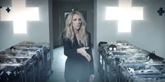 Céline Dion blows black glitter on newborns in a commercial for