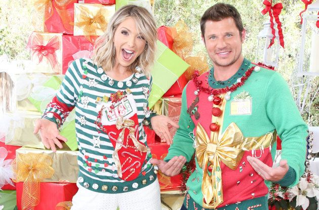TV hosts Debbie Matenopoulos and Nick Lachey visit Hallmark's 'Christmas In July' wearing ugly Christmas