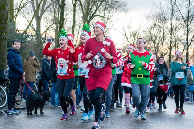 People take part in an Ugly Christmas Sweater Run on Dec. 16, 2017 in