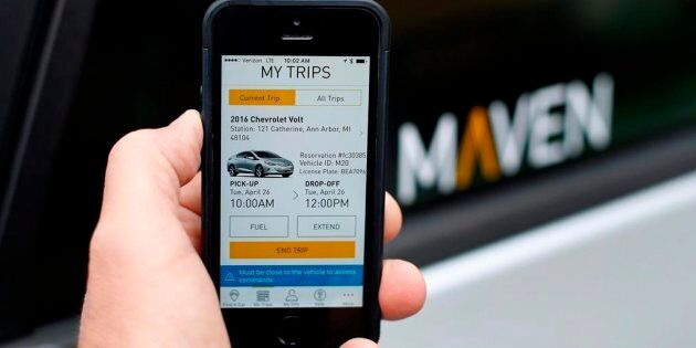 A smartphone displays the Maven app, a General Motors car-sharing service, in Ann Arbor, Mich., on April...