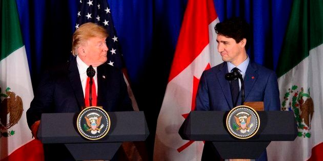 Prime Minister Justin Trudeau and President Donald Trump at the signing ceremony for the new United States-Mexico-Canada...