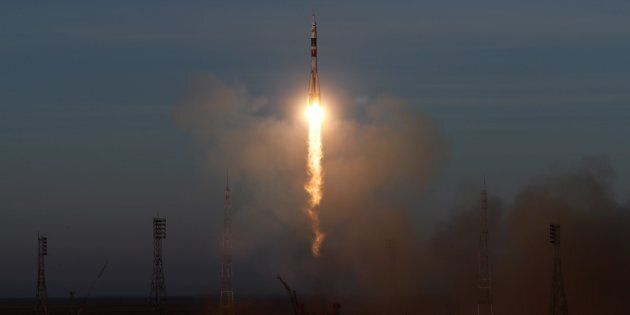 The Russian Soyuz booster rocket FG with Soyuz MS-11 spacecraft lifts off from the launch pad at Baikonur...