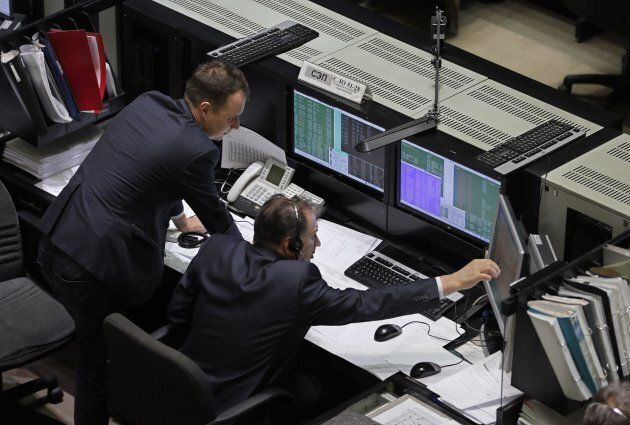 Specialists work at the Mission Control Center in the city of Korolev outside Moscow, Russia 03 December...