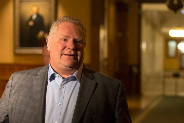 Ontario Premier Doug Ford leaves an early morning caucus meeting at the Ontario legislature in Toronto...