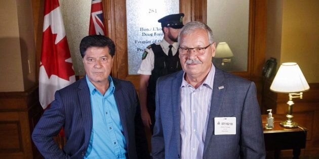 President of Unifor Canada Jerry Dias poses with Ontario Public Service Employees Union president Warren...