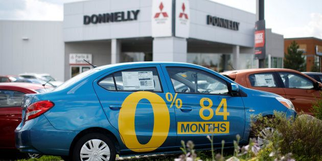 A car advertises an 84-month (seven-year) loan term at a Mitsubishi dealership in Ottawa, Ont., July...
