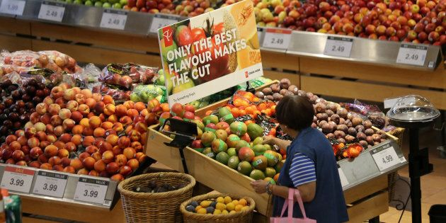 A woman browses in the fruit section of a Loblaw supermarket in Collingwood, Ont., July 28, 2017. The...
