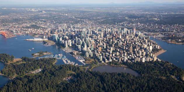 An aerial view of Vancouver's downtown and West End, with Stanley Park in the foreground. Vancouver home...
