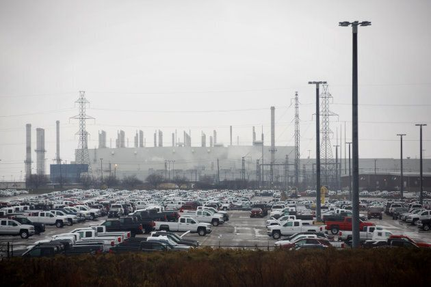 Vehicles sit parked outside of the General Motors Oshawa assembly plant in Oshawa,