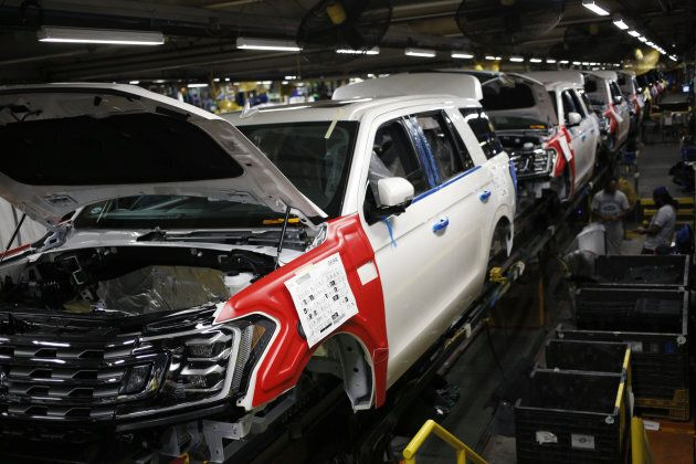 Ford Motor Expedition sports utility vehicles (SUV) move down an assembly line at Ford Kentucky Truck...