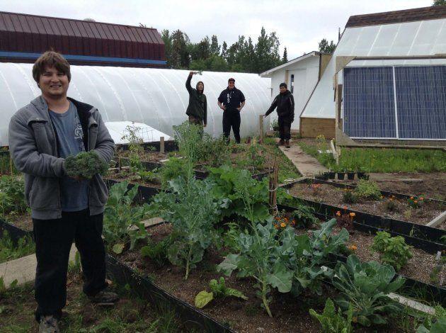 Staff of Grow North, Leaf Rapids' community garden, at the school gardening facility.