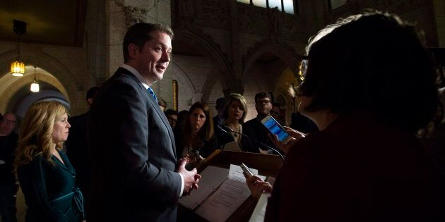 Tory Leader Andrew Scheer speaks with reporters as Conservative MP Michelle Rempel (left) looks on following...