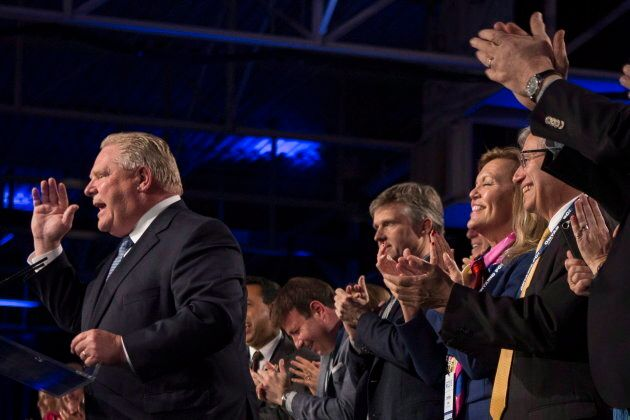 Ontario Premier Doug Ford, left, receives the applause of his caucus as he addresses the Ontario PC Convention...