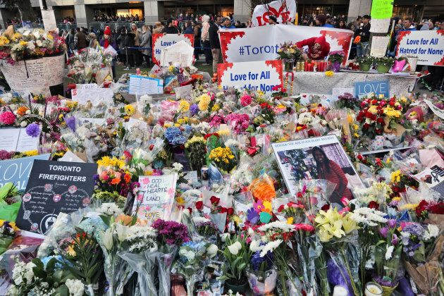 Flowers and messages at a memorial during an inter-faith vigil at Nathan Phillips Square in memory of the 10 people killed and 16 people after the deadly van attack.