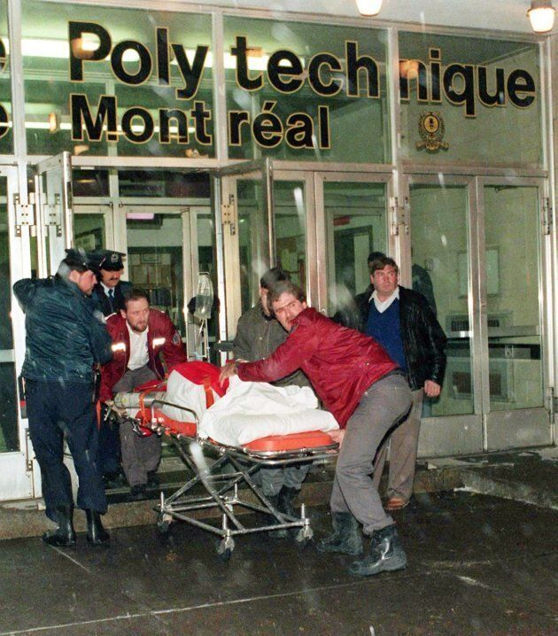 An injured person is wheeled away from the Université de Montréal after a gunman opened fire in a packed classroom in Montreal on Dec. 6, 1989.